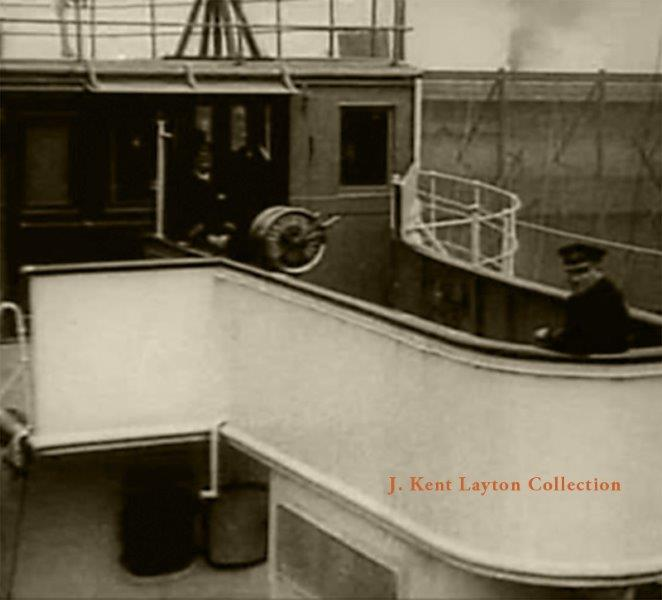 Captain Turner spots a film crew on the New York pier as the Lusitania departs for the last time. © J Kent Layton Collection