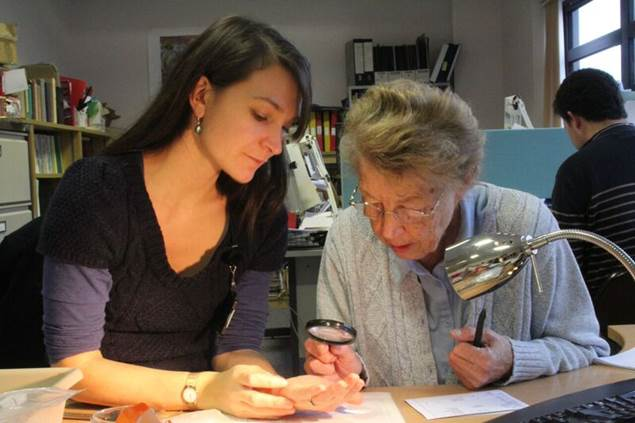 PhD student Denise identifying Roman coins