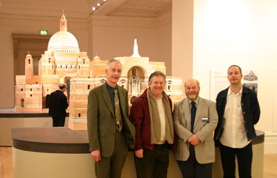 4 men in front of cathedral model