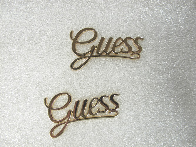 Metal 'Guess' belt buckles
