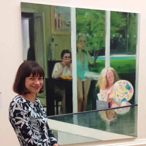 Caroline Walker (artist) standing in front of 'Consulting the Oracle' painting
