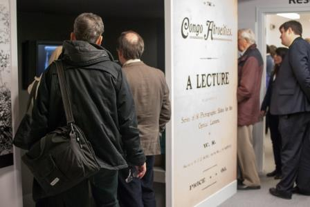 Photograph of display with visitors and entrance to Congo Atrocities lecture
