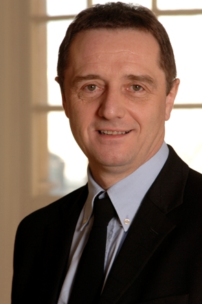 Head and shoulders shot of David Fleming in suit and tie