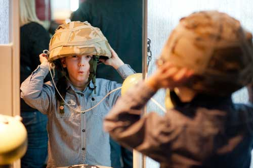 Image of boy trying on helmet