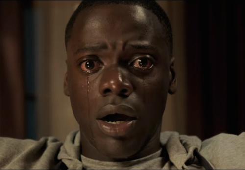 Image of a Black man's face, wide eyed and crying