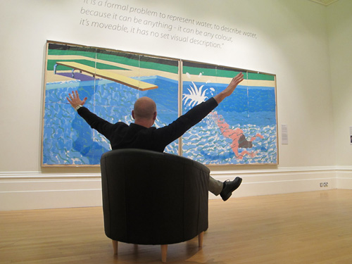 Picture of a man in a seat viewing Hockney's 'Le Plongeur'