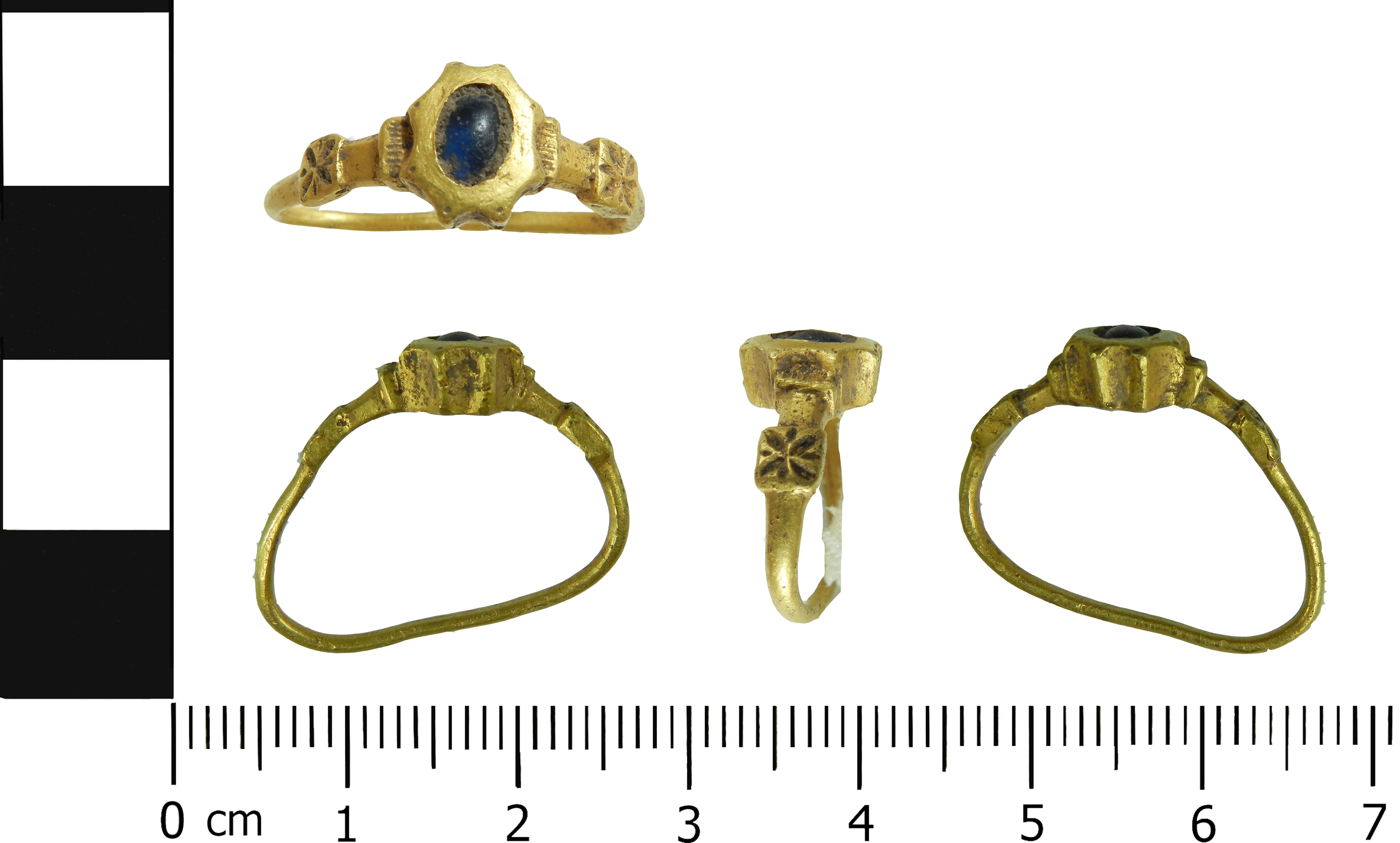 Gold and cobalt blue glass finger ring dating to the 14th century.
