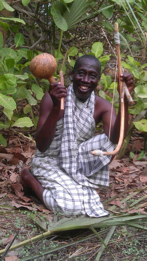 "Malou Diatta with Kambalaon harp and ""Leaf-Master"" Gourd. Photo courtesy: Owen Burnham 2012."