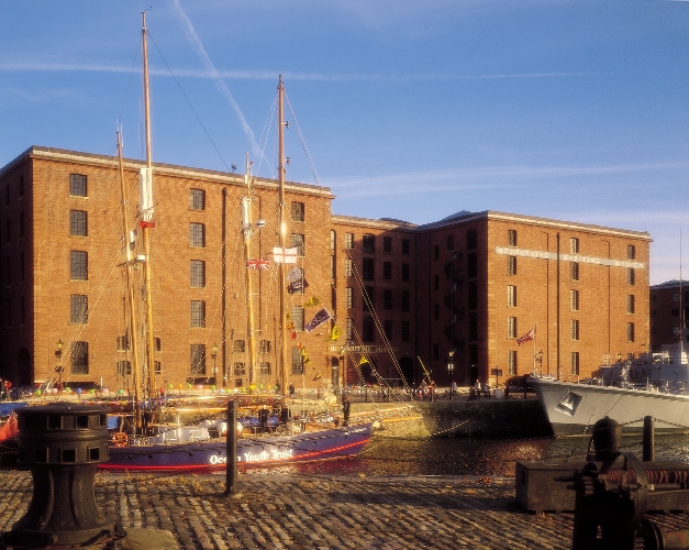 Merseyside Maritime Museum on sunny day with boats in dock