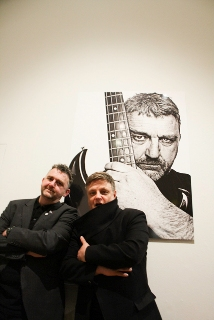 Photo of Phil next to Rankin in Walker Art Gallery in front of a large photograph of Phil.