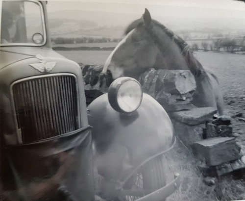 Village of Rhosgadfan in summer 1958. The car cover over the lower part of the front grill helped to prevent cool morning air entering the engine, enabling the engine to warm up quickly.