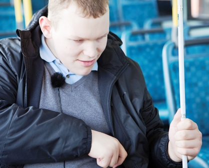 Robbie (a pupil at St Vincent's School) on the bus as part of his mobility training session.