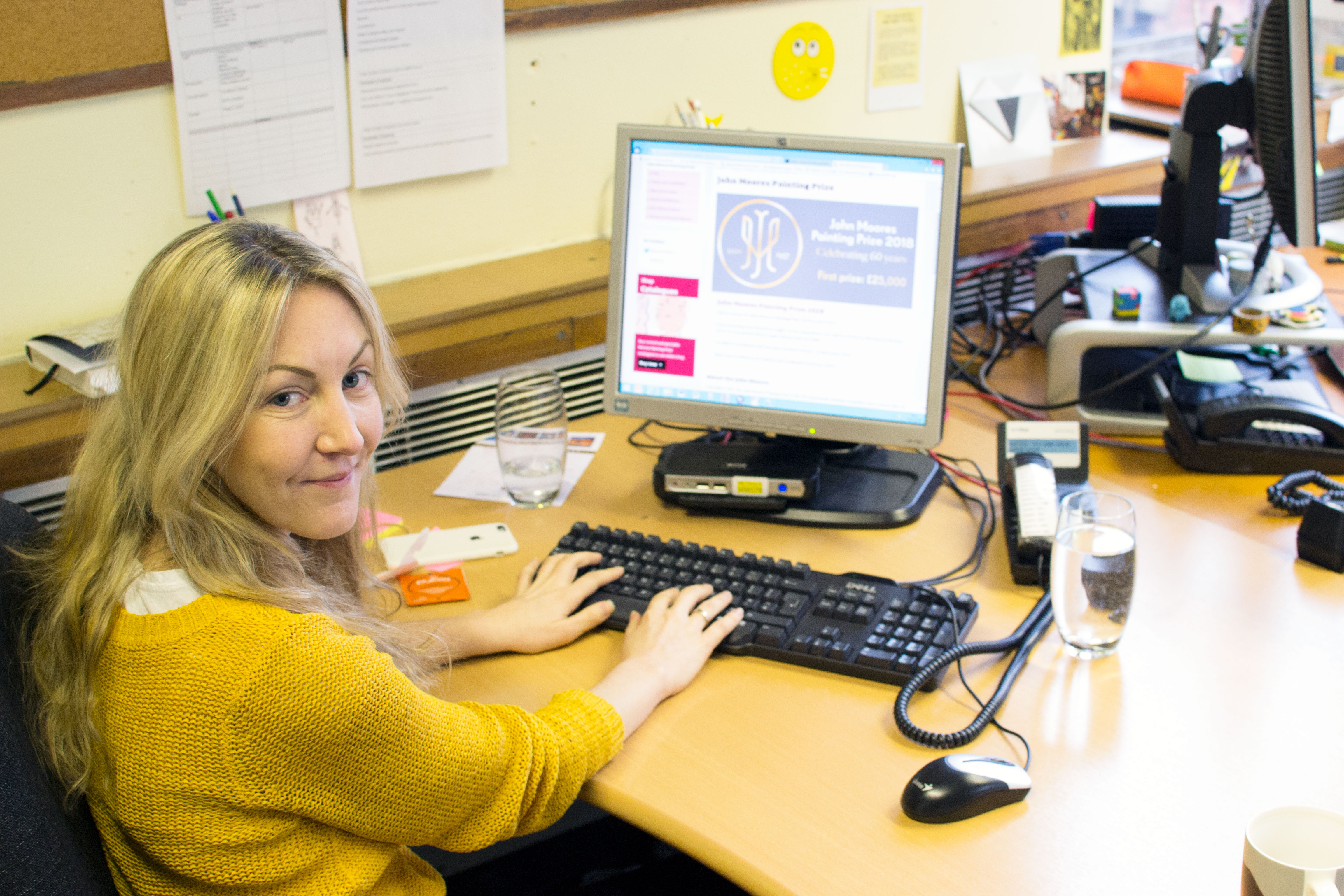 Alex Patterson at her desk working
