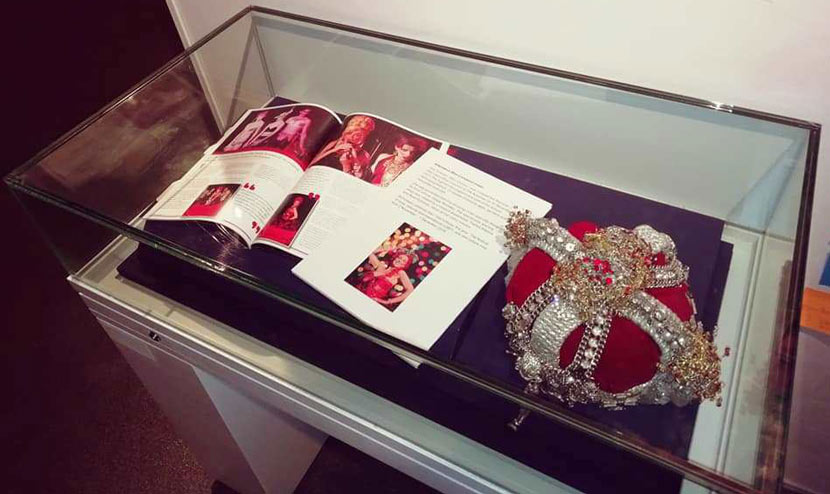 crown and photographs of the Alternative Miss Liverpool in museum display