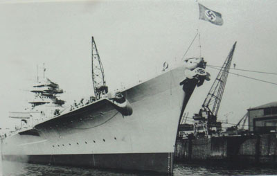 black and white photo of a large ship with a swastika flag