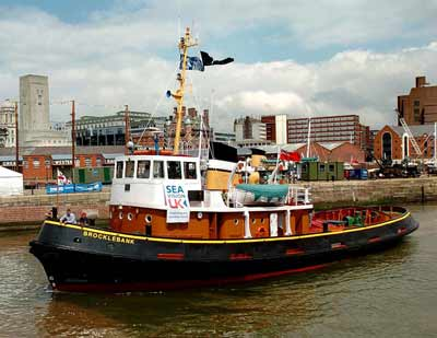 photo of a modern tug boat in a do