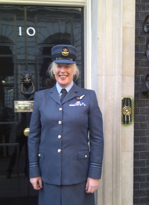 Caroline Paige in Royal Air Force uniform at the door of number 10