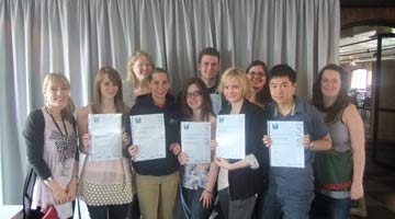 Group of volunteers holding their certificates