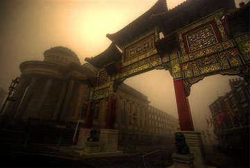 Large Chinese arch in hazy yellow fog