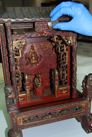 Chinese shrine being cleaned.