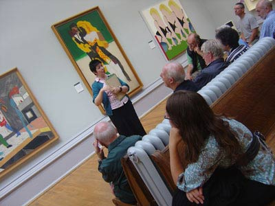 curator on art gallery talking to a group of visitors