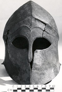 grey metal helmet with eye holes and nose & cheek cover