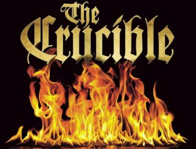 The words The Crucible in a graphic style above a picture of burning flames