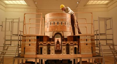 conservator working on model of cathedral