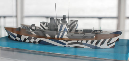 model ship decorated with a geometric pattern in contrasting colours