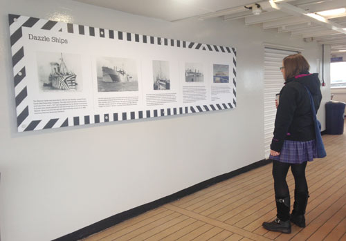 ferry passenger looking at dazzle ship display