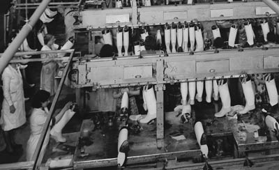 women making rubber boots in a factory