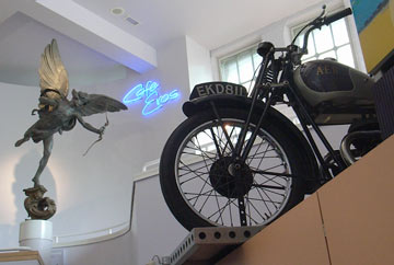 interior showing Cafe Eros and motorbike on display