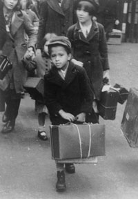 archive photo of a young Black evacuee holding a suitcase
