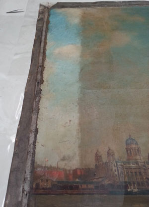 detail of painting with one  narrow strip cleaned