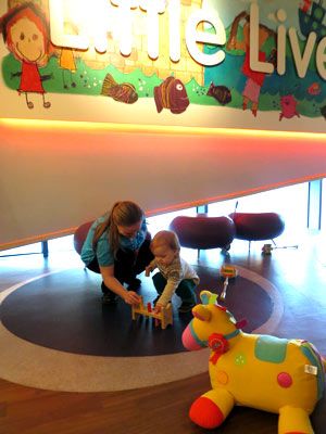 mother and child playing with toys at the museum