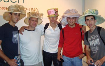 A group of male students in ladies hats