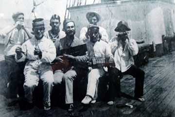 Archive photo of sailors playing musical instruments on the deck of a ship