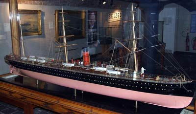 Large ship model in a display case on a gallery