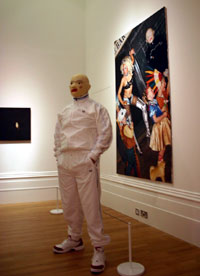 Gary Sollars in front of his painting in John Moores 24
