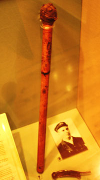 A wooden staff in a display case