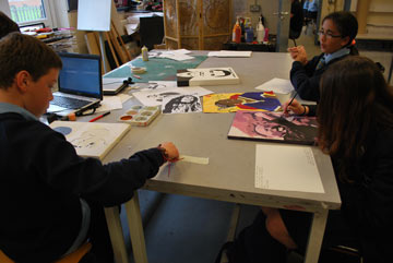 School children at a desk creating artwork inspired by Black achievers