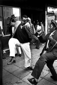 photo of men dancing in the street