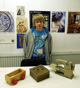 Work experience student with museum objects