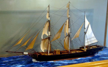model sailing ship in a display case