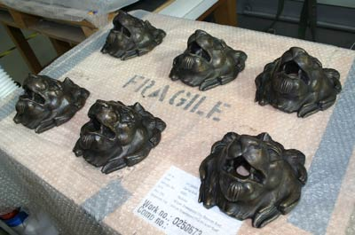 Six casts of a lion head from a Liverpool fountain