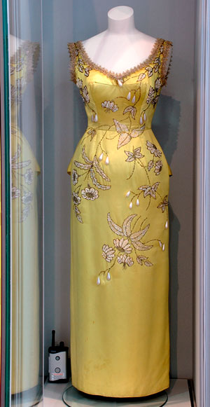 dress decorated with elaboare embroidery, in museum display