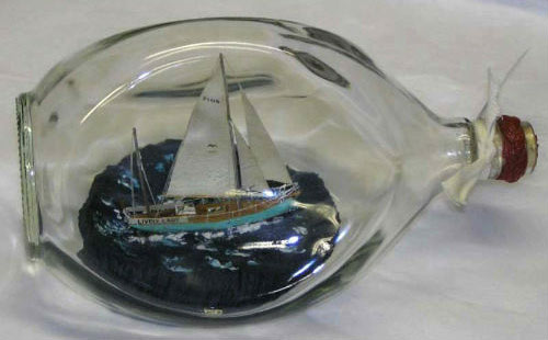 'Lively lady' model sailing ship in a bottle.