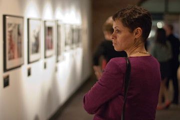 woman looking at framed photographs