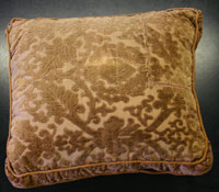 brown patterned cushion with repaired corner