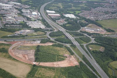 aerial photo of motorway junction with excavation site in foreground